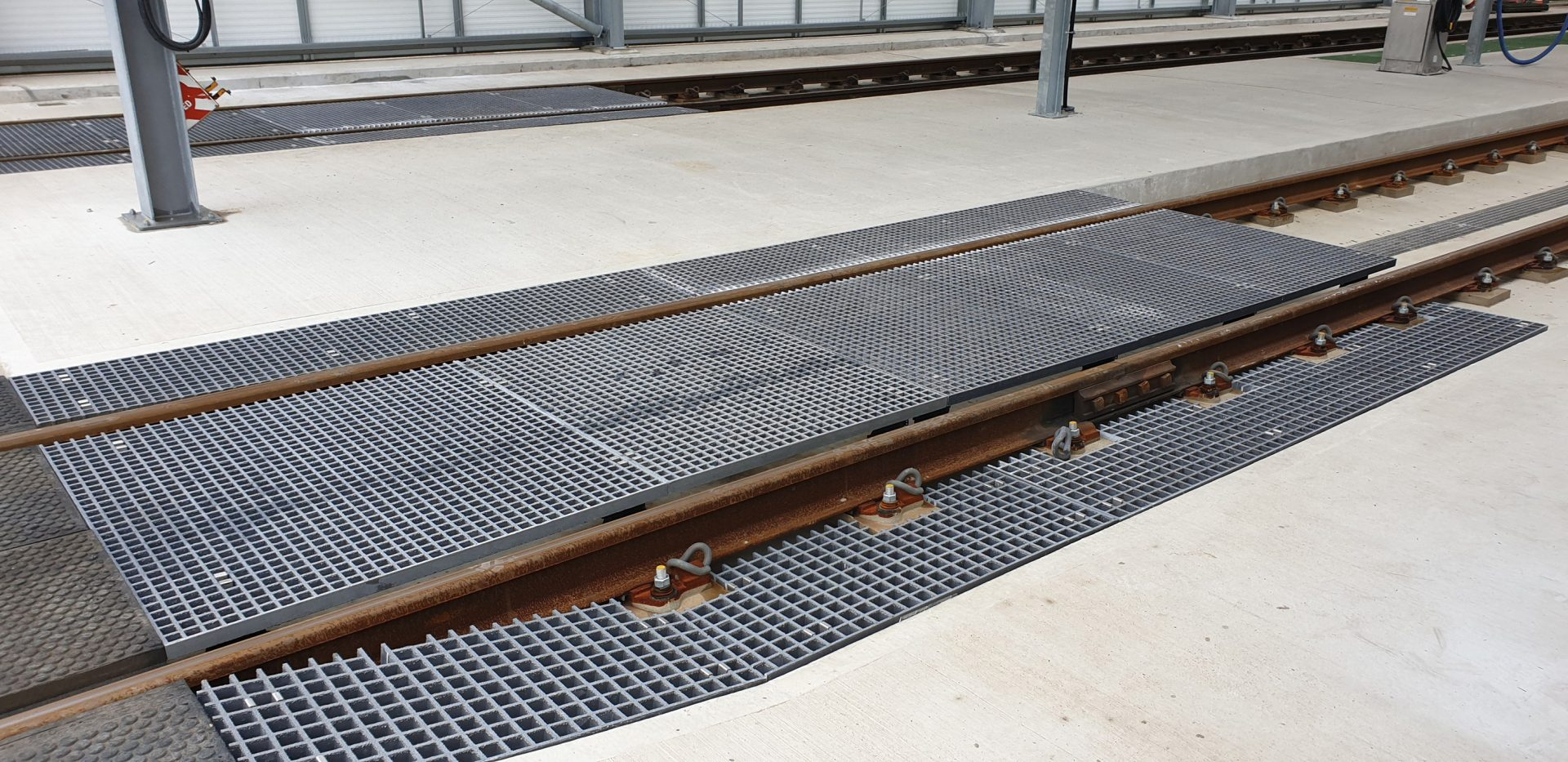 Fibreglass grating train care depot crossing points