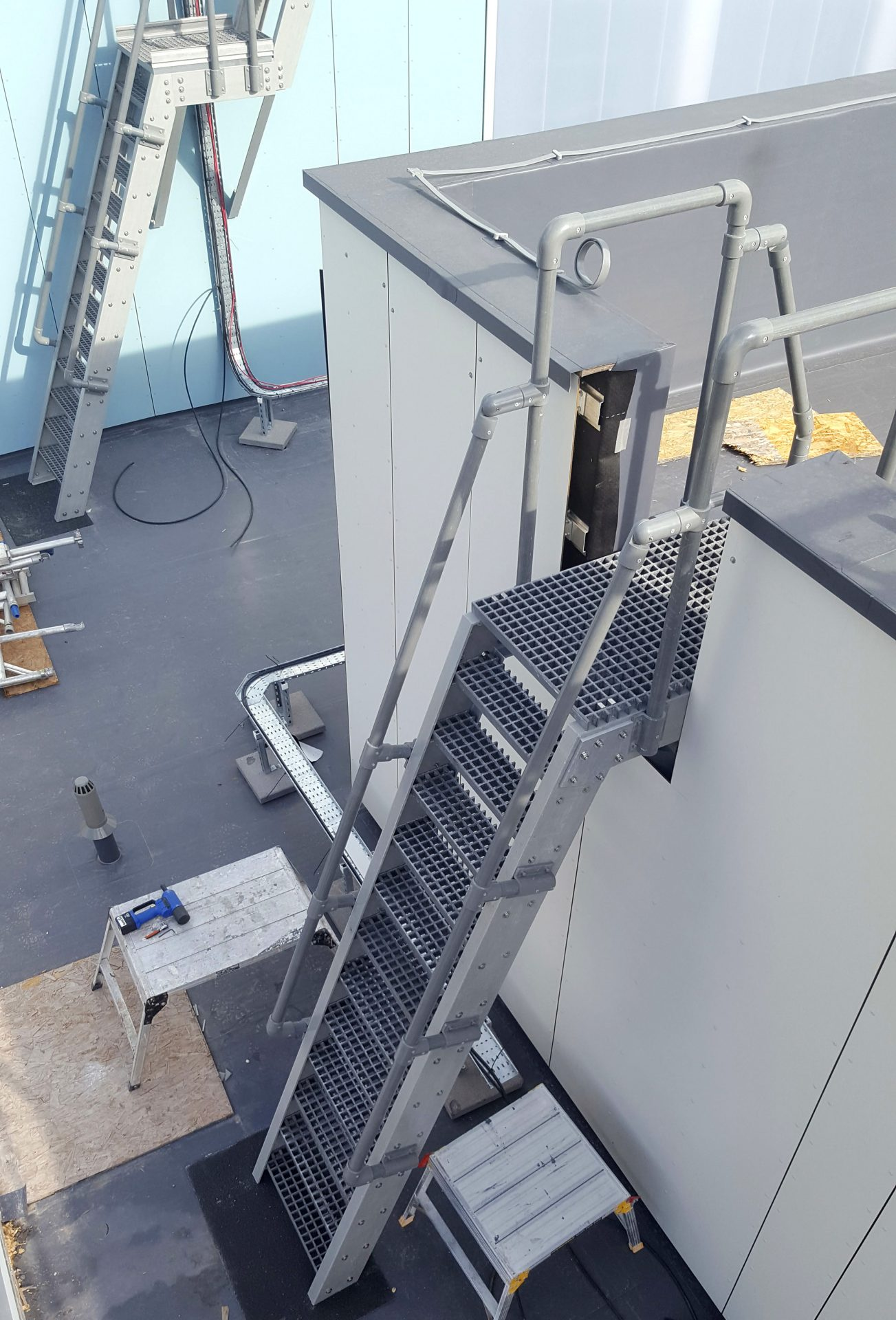 GRP Glass fibre fixed roof access ladders during installation