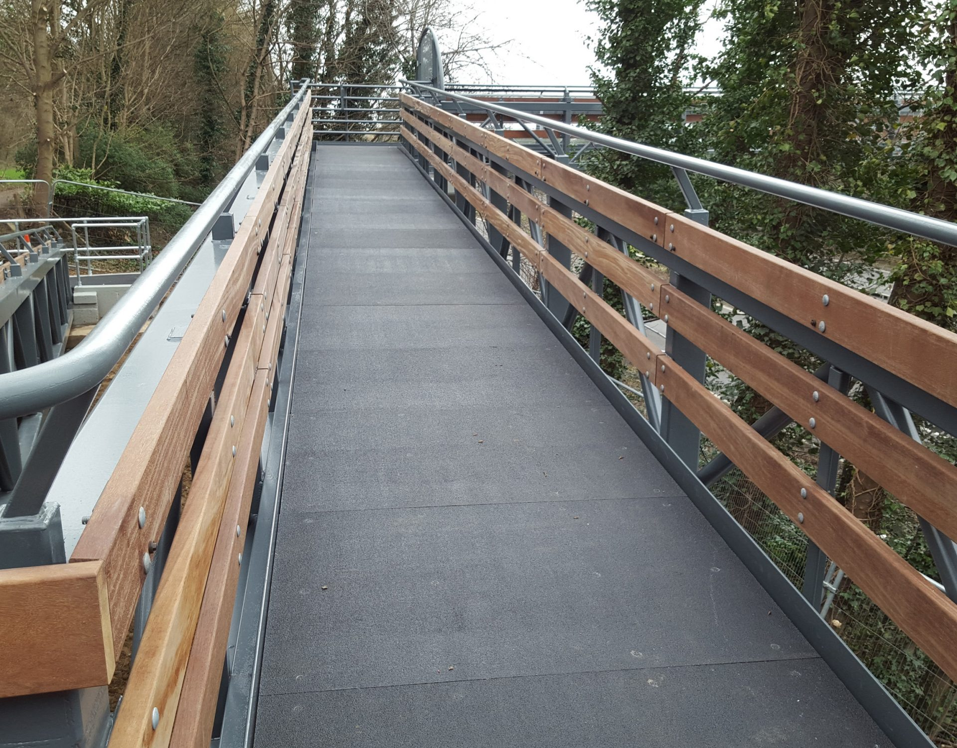 GRP deck pedestrian access walkway retail centre steel structure