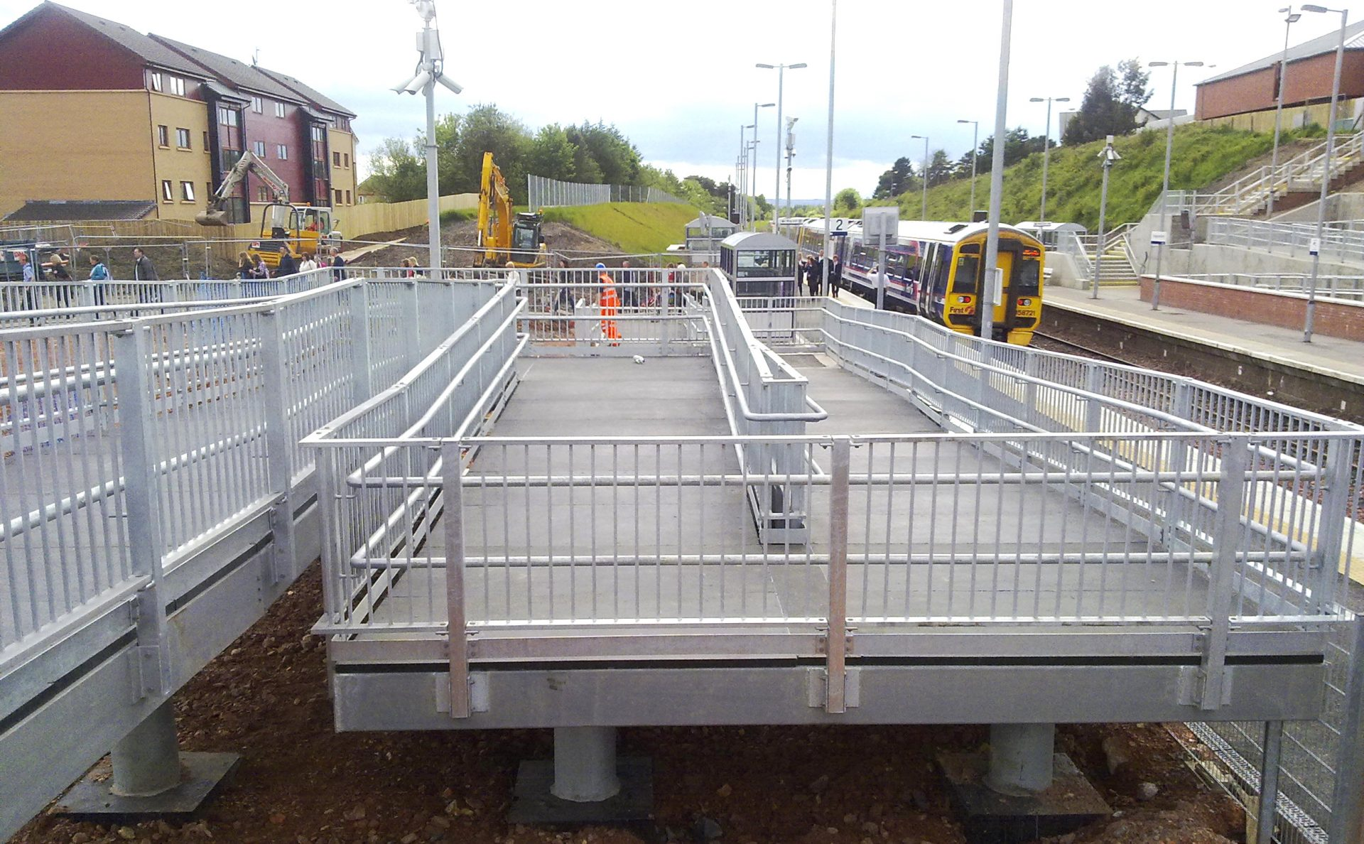 GRP deck pedestrian walkway railway station access ramp with steel structure