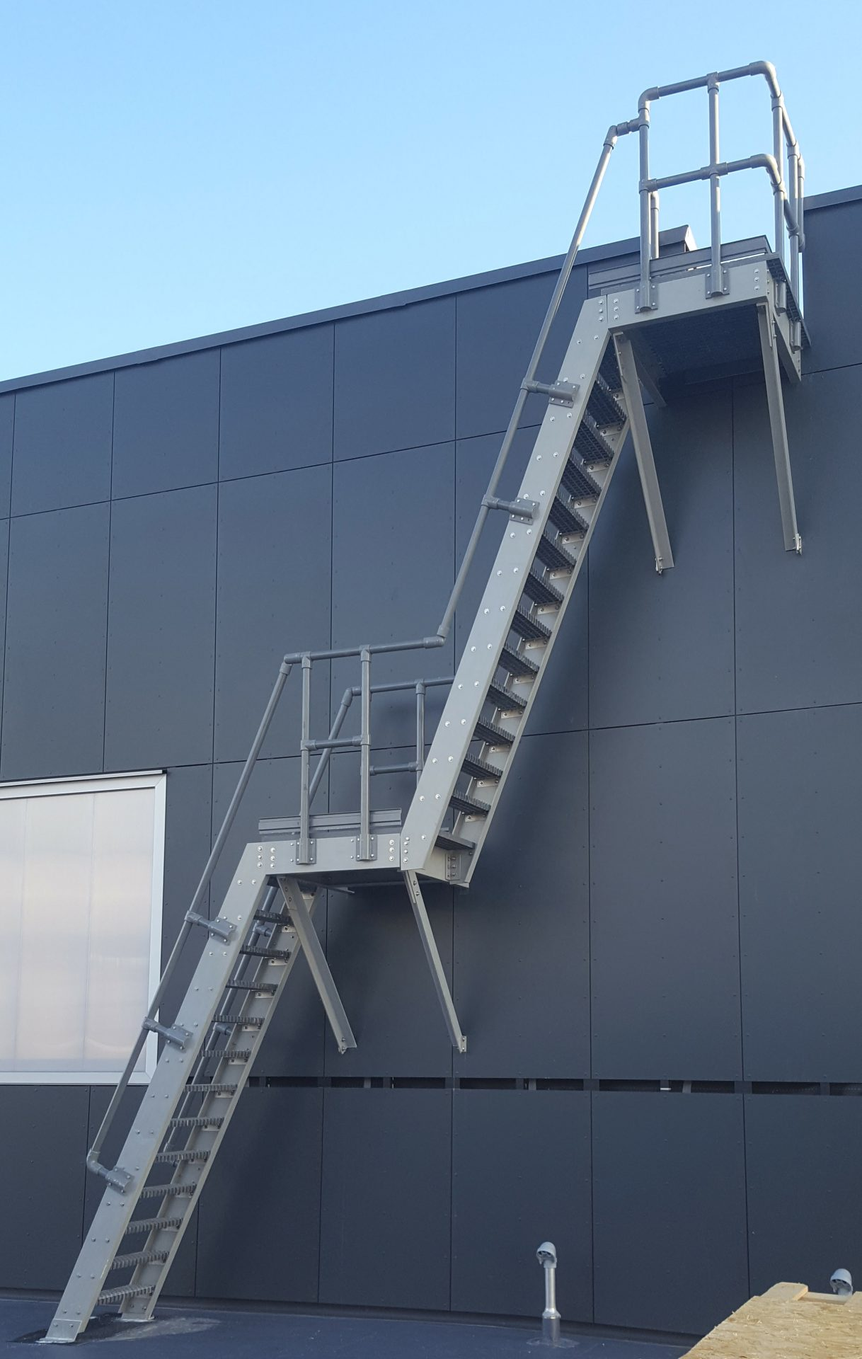 GRP fixed roof access ladder with landings and handrails