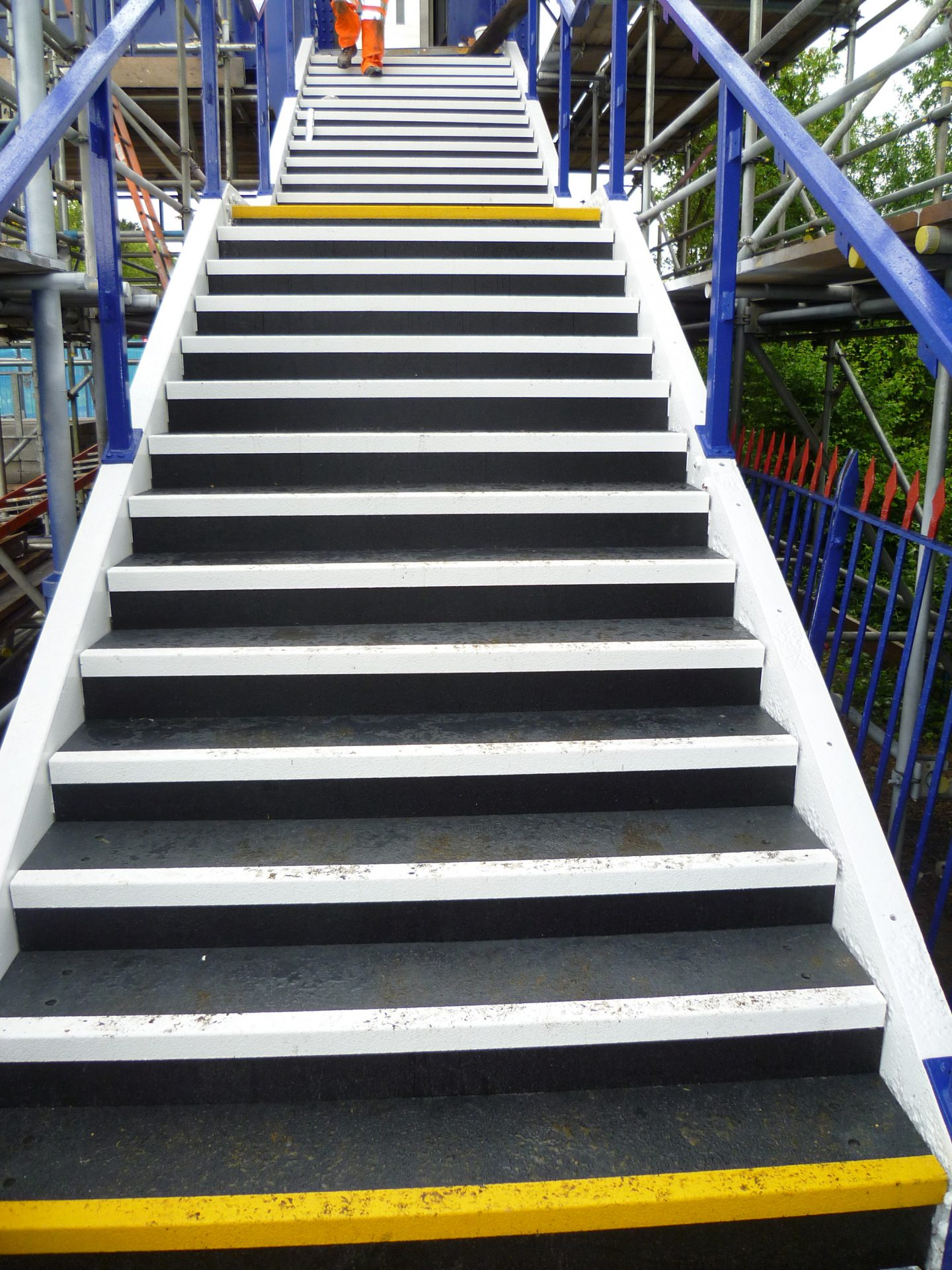 GRP load bearing stair treads fitted to cast iron footbridge