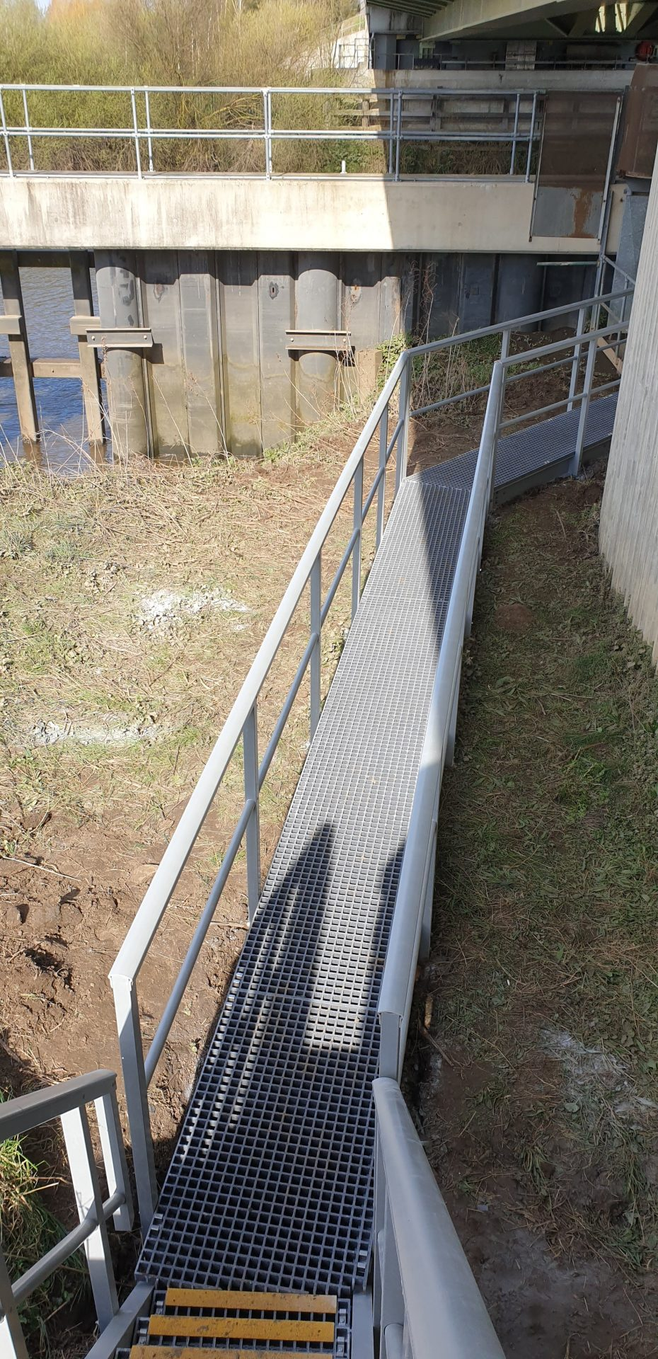 GRP raised access walkway with guardrail road bridge maintenence access aerial view