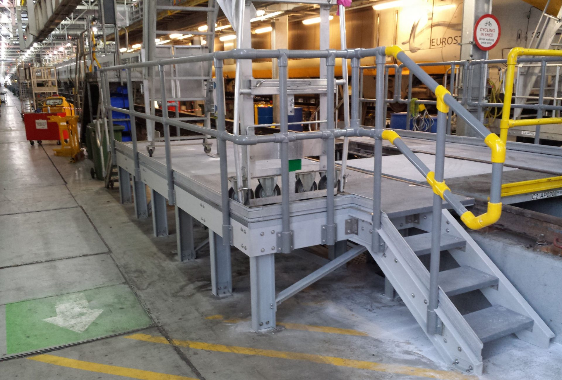 Glass fibre GRP composite fixed work platform with guardrail and step access