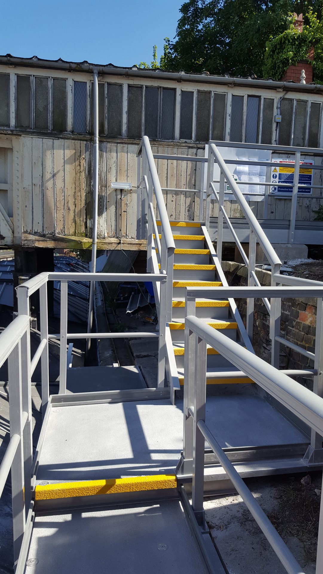 Lightweight Fibreglass Stairs, walkway and landing - railway station roof