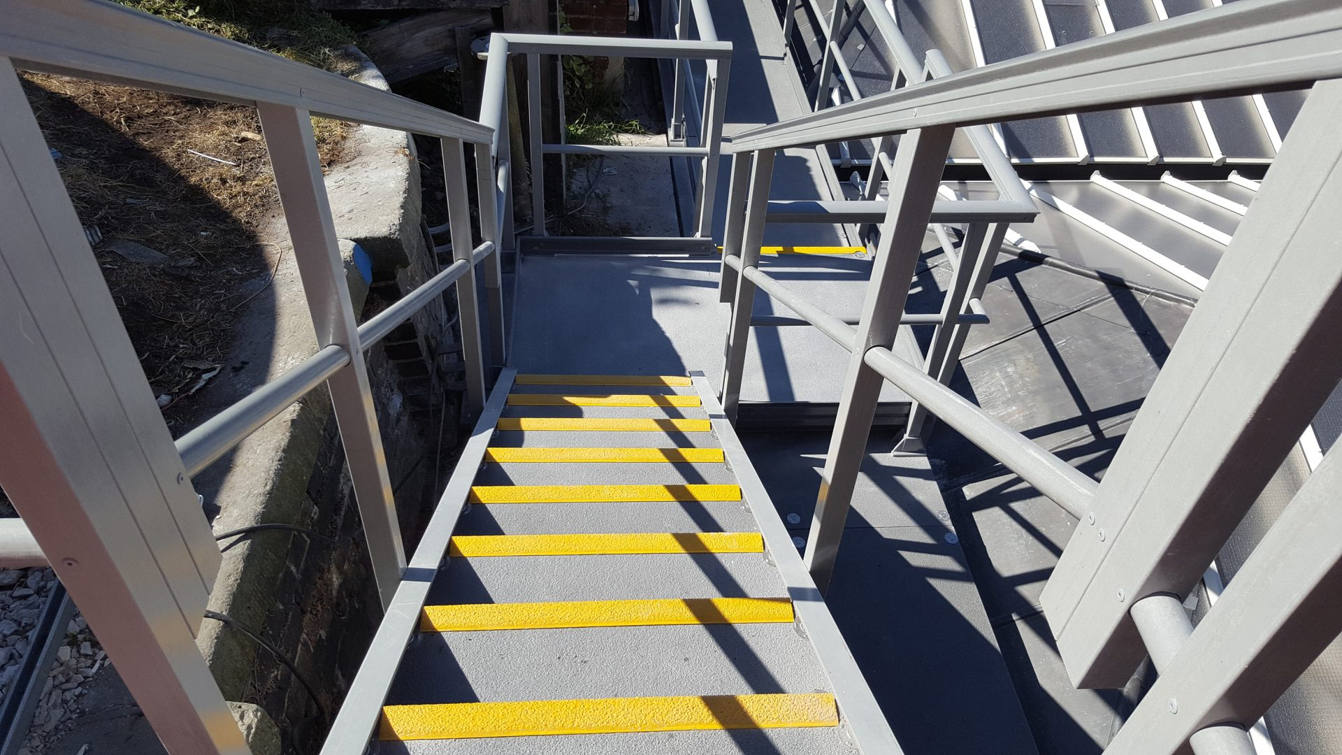 Replacement GRP Stairs and Walkway railway station roof
