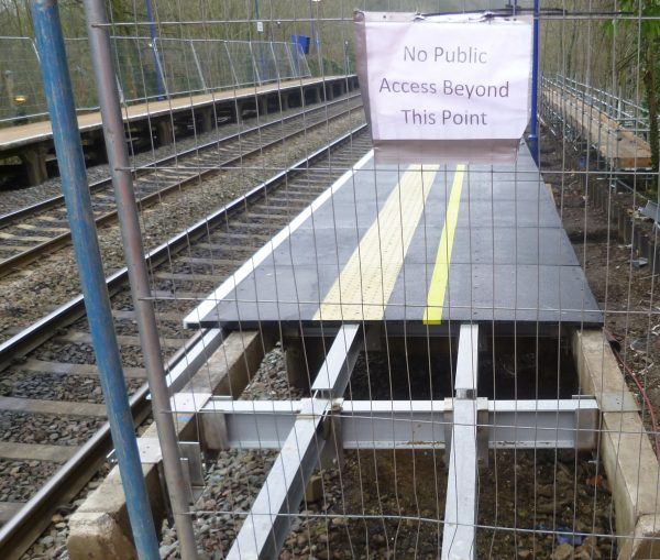 Railway platform refurbishment incorporating fibreglass beams and decking