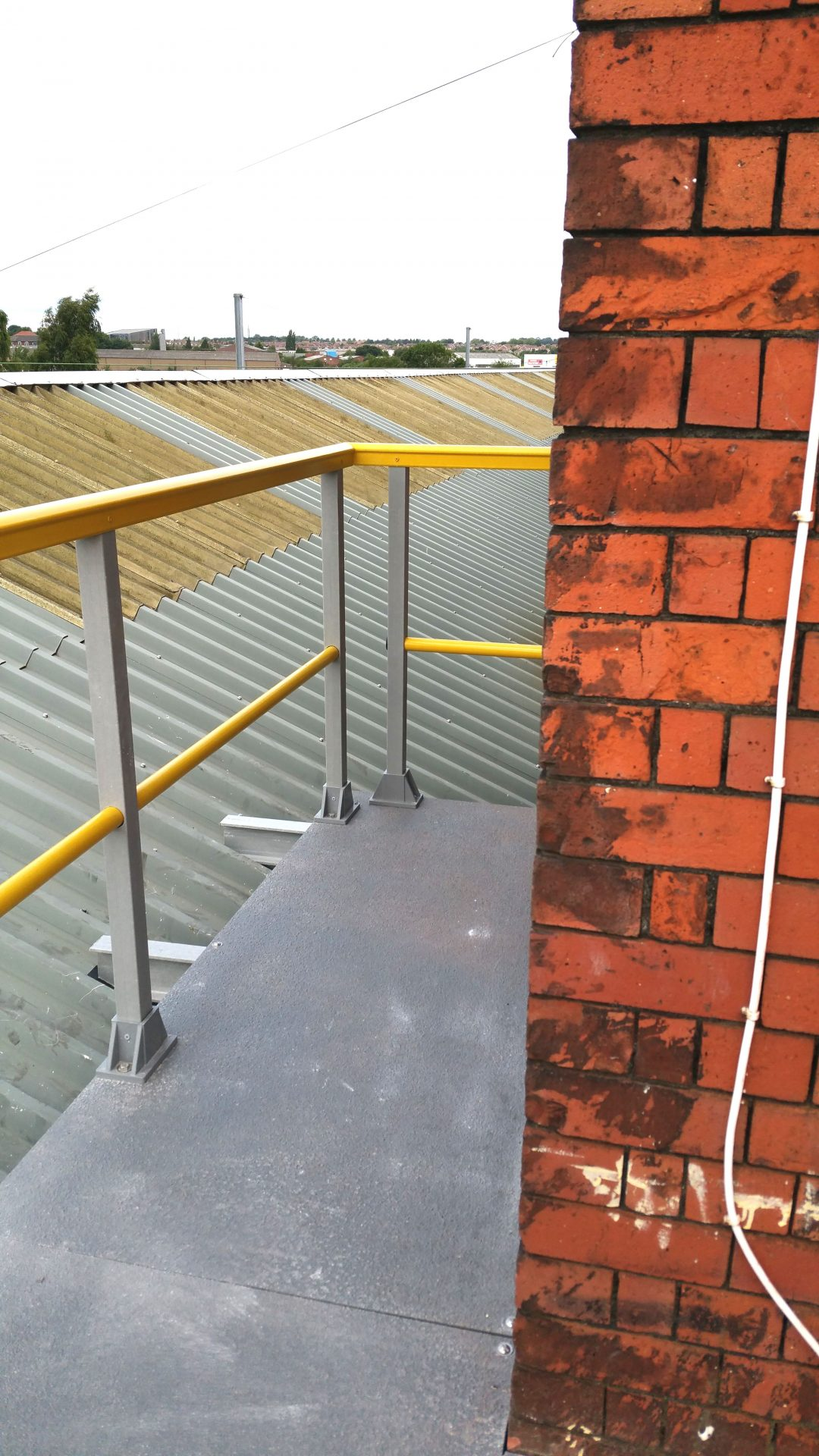Roof walkway platform with new GRP panels and guard rail