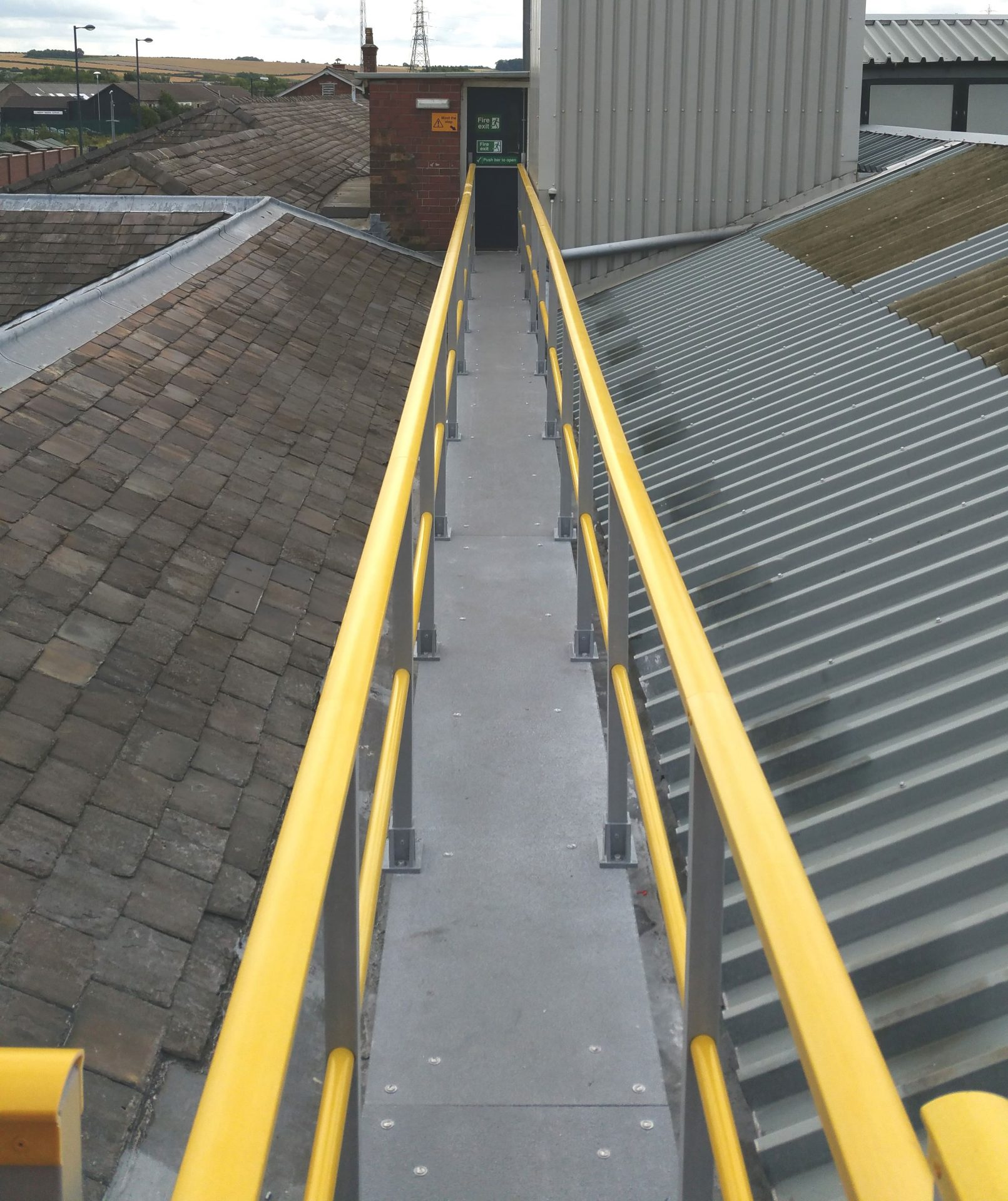 Roof walkway with new GRP panels and guard rail