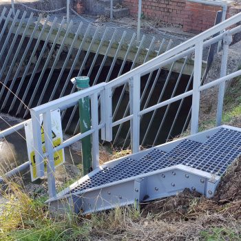 EA drainage ditch level monitoring GRP access steps with guardrail